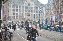 Woman riding in front of a tram in Amsterdam
