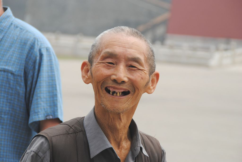 Smiling man posing for picture at Forbidden City in Beijing, China