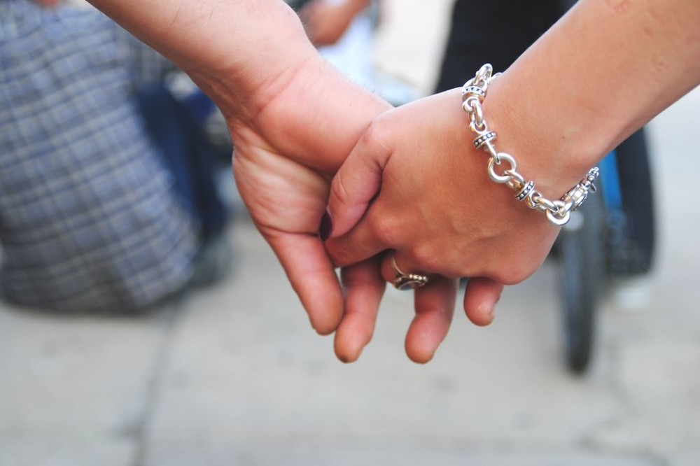 Couple holding hands in Austin, TX