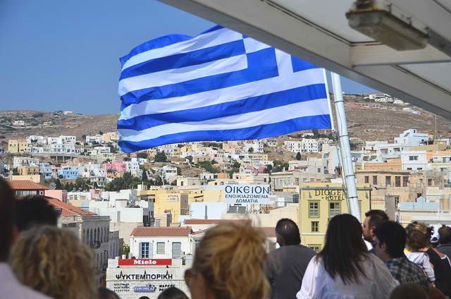 Greek flag flying over boat