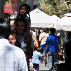 Girl On Fathers Shoulders in Chile