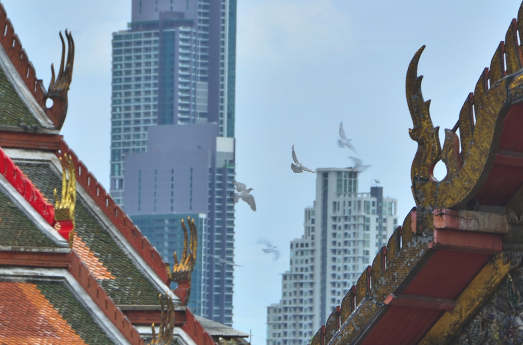 Looking back toward modern Bangkok from Wat Prayun puts the city's skyscrapers in an almost surreal context