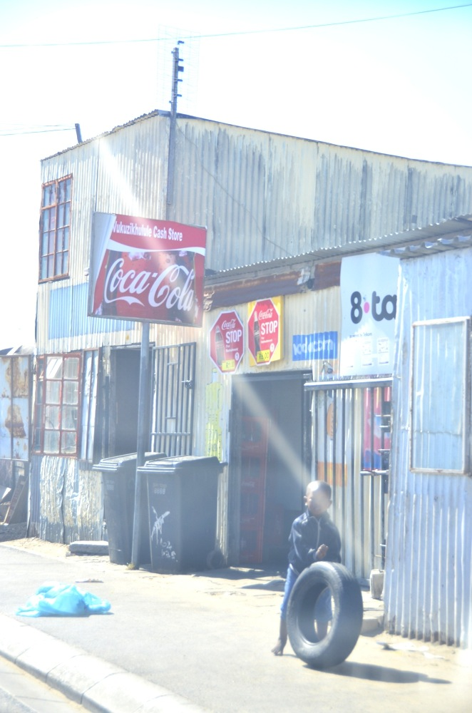 The clash of big brand names with the lives of Khayelitsha children is almost chilling