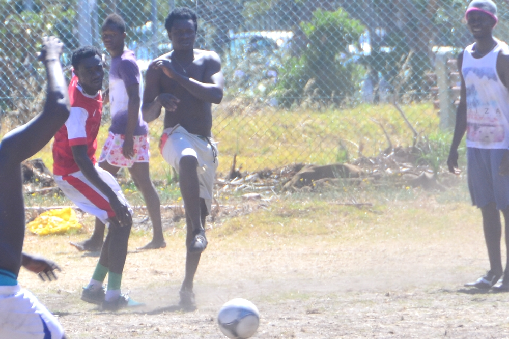 Catch a soccer game on the streets near Green Point