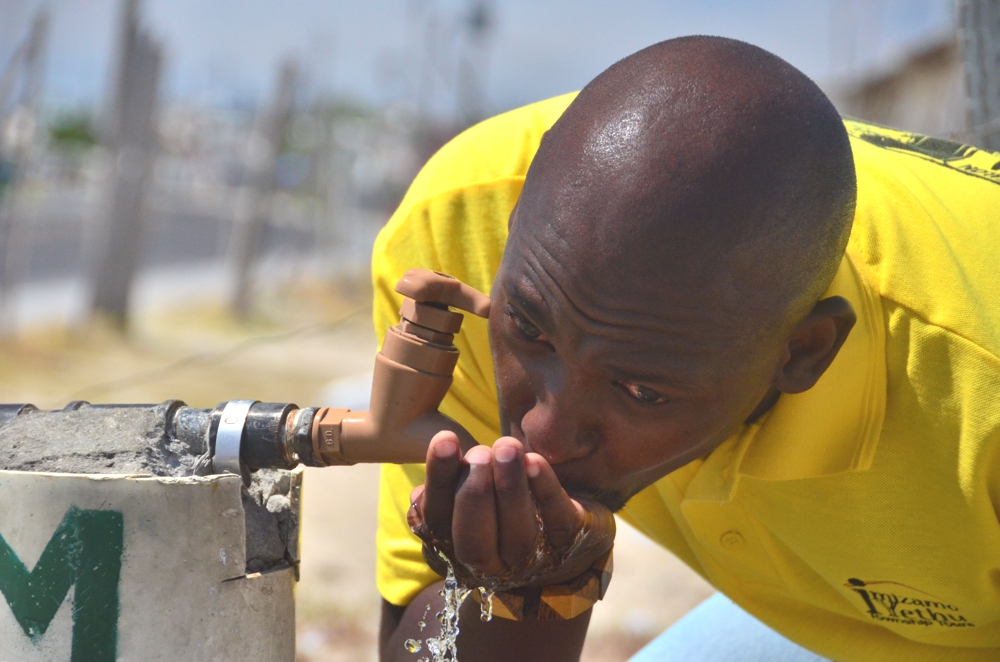 Khayelitsha thankfully has safe drinking water, as Mzu demonstrates