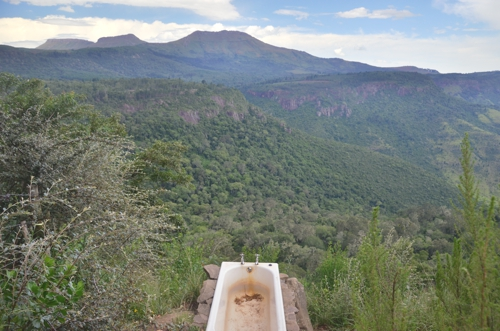 Yes, you can actually take a bath above this scenery at Away With The Fairies in Hogsback