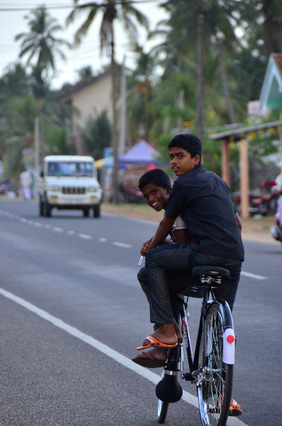 Boys biking in Arugam Bay Town