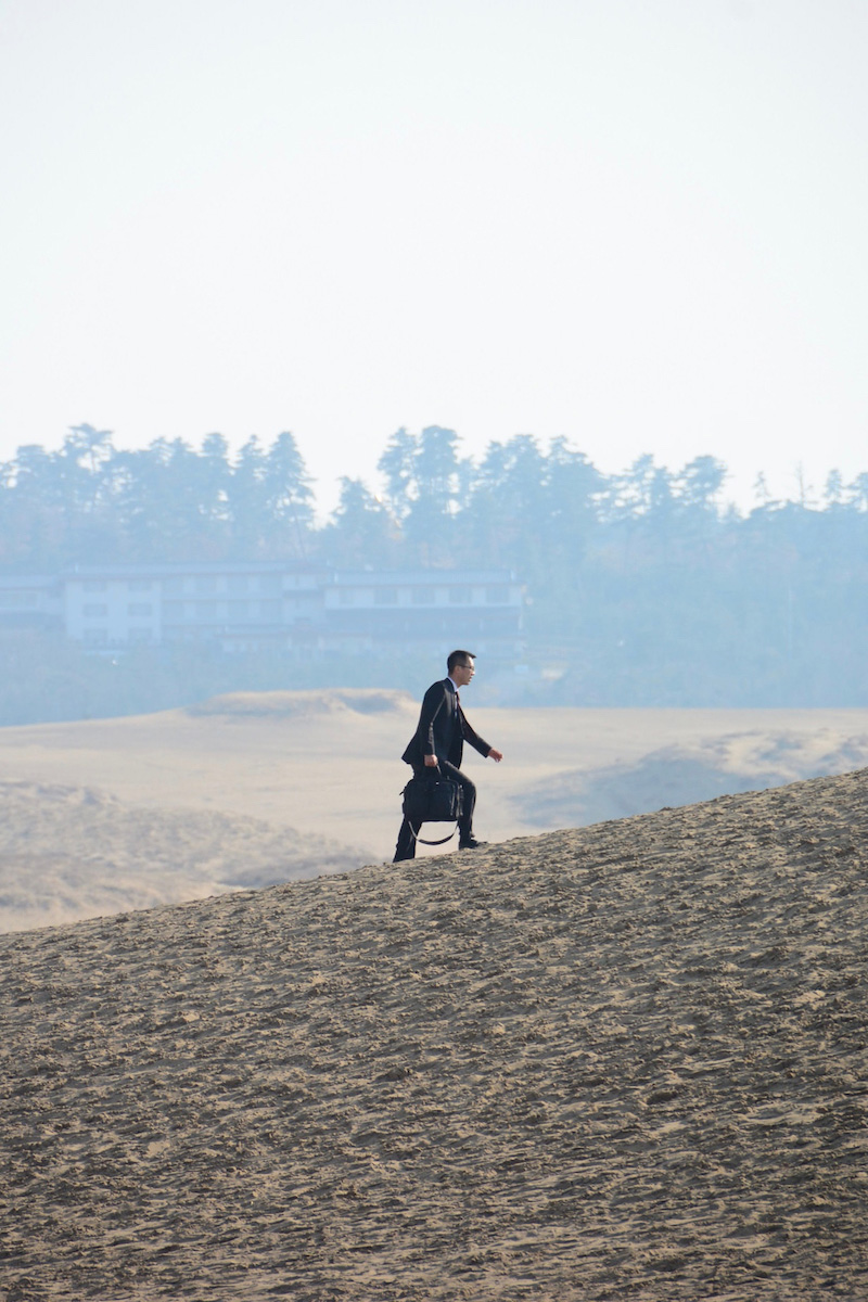 Salaryman in desert in Tottori, Japan