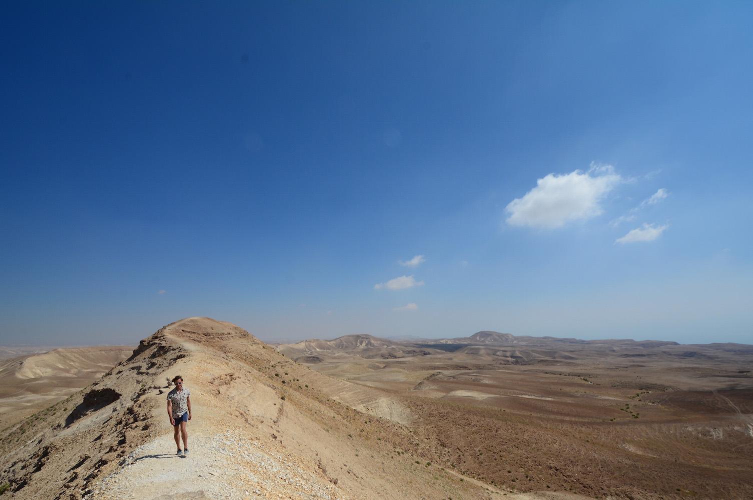 Robert Schrader hiking on a mountain ride in Judean desert