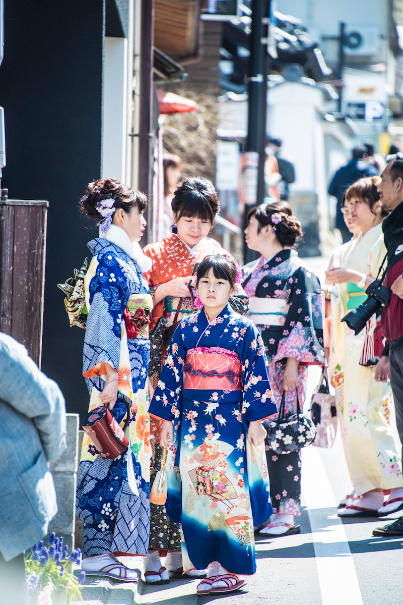 Asian tourists dressed as geishas in Kyoto