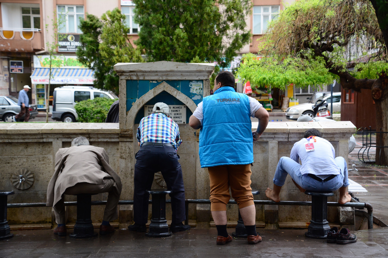 Men Washing Before Prayers in Konya, Turkey