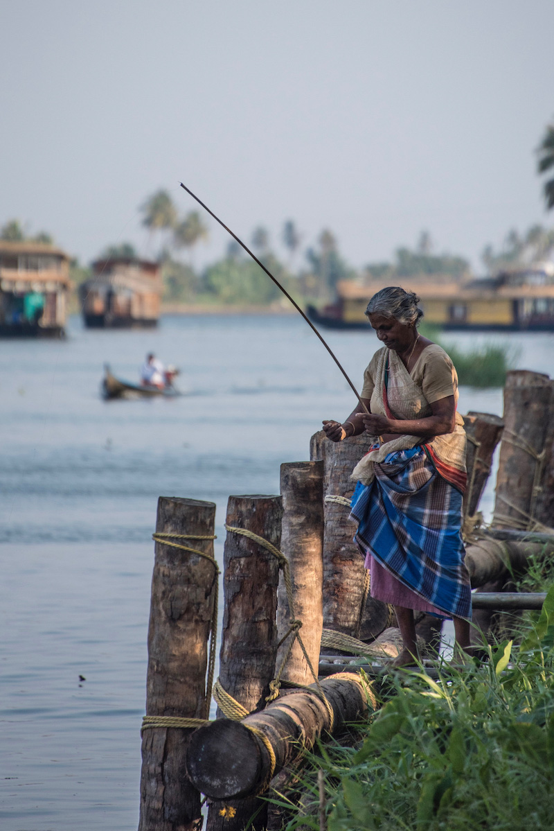 Woman fishing in Kerala, India